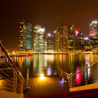 Stock Photo: Singapore in night time with water reflections.