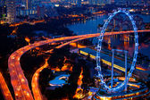 Aerial view on Singapore Flyer from Marina Bay Sands resort at night — Stock Photo