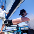 Sailor participates in sailing regatta Sail & Fun Trophy 2012 — Stock Photo