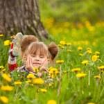 Lovely little five-year girl lying in grass — Stock Photo