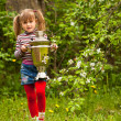 Lovely little girl and Russian Samovar in the garden. - Stok fotoraf