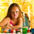 Little girl artist, drawing paint with paint of face. — Stock Photo #12432791