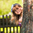 Foto Stock: Funny lovely little girl playing in the park