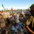 Poor from Java island working in a scavenging at the dump on Bali, Indonesia. — Stok fotoğraf