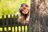 Funny lovely little girl playing in the park — Stock Photo