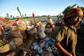 Poor from Java island working in a scavenging at the dump on Bali, Indonesia. — Stock Photo
