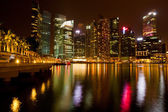 Singapore business district in the night time with water reflections — Stock Photo