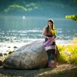 Young woman near the river in summer — Stock Photo