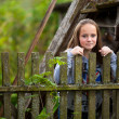 Teen-girl standing near vintage rural fence. — Stock Photo
