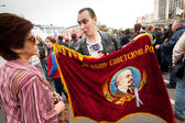An opposition supporter holds a Soviet era flag — Stock Photo