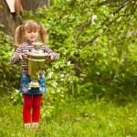 Lovely little girl posing with the Russian Samovar on park. — Stock Photo