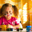 Foto Stock: Little child, drawing paint with paint of face, make-up