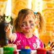 Stock Photo: Beautiful little girl artist with paint of face