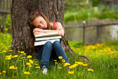 Tired school girl in the park — Stock Photo