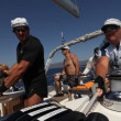 "Stock Video: Sailors participate in sailing regatt""VivGreece 2012"" on September 23, 2012 on Saronic Gulf, Greece."