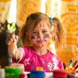 Little child, drawing paint with paint of face. — Stockfoto