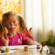 Beautiful little girl artist with paint of face. — Stock Photo