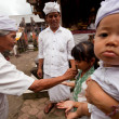 BALI, INDONESIA - MARCH 28: Unidentified child during the ceremonies of Oton - is the first ceremony for baby's on which the infant is allowed to touch the ground on March 28, 2012 on Bali, Indon — Stock Photo