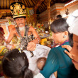 BALI, INDONESIA - MARCH 28: Unidentified child during the ceremonies of Oton - is the first ceremony for baby's on which the infant is allowed to touch the ground on March 28, 2012 on Bali, Indon — Stok fotoğraf