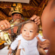 Stock Photo: BALI, INDONESI- MARCH 28: Unidentified child during ceremonies of Oton - is first ceremony for baby's on which infant is allowed to touch ground on March 28, 2012 on Bali, Indon