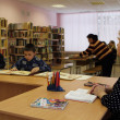 Open Day at the Podporozhye's Children House - unknown children in the library read books with teachers — Stock fotografie