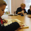 Open Day at the Podporozhye's Children House - unknown children in the library read books with teachers - Stock Photo