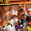 BALI, INDONESIA - MARCH 28: Unidentified child during the ceremonies of Oton - is the first ceremony for baby's on which the infant is allowed to touch the ground on March 28, 2012 on Bali, Indon — Stockfoto