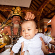 BALI, INDONESIA - MARCH 28: Unidentified child during the ceremonies of Oton - is the first ceremony for baby&amp;#039;s on which the infant is allowed to touch the ground on March 28, 2012 on Bali, Indon - Stock Photo