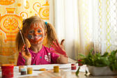 Beautiful little girl artist with paint of face. — Foto de Stock
