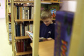 Open Day at the Podporozhye's Children House - unknown children in the library read books with teachers — Stock Photo