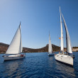 "SARONIC GULF,  GREECE - SEPTEMBER 23: Boats Competitors During of sailing regatta ""Viva Greece 2012"" on September 23, 2012 on Saronic Gulf,  Greece. - Stock Photo"