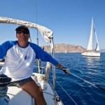 "SARONIC GULF, GREECE - SEPTEMBER 23: Sailors participate in sailing regatta ""Viva Greece 2012"" on September 23, 2012 on Saronic Gulf, Greece. — Stock Photo #13481779"