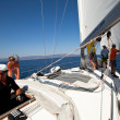SARONIC GULF,  GREECE - SEPTEMBER 23: Sailors participate in sailing regatta &amp;quot;Viva Greece 2012&amp;quot; on September 23, 2012 on Saronic Gulf, Greece. - Stock Photo