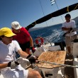 "SARONIC GULF,  GREECE - SEPTEMBER 23: Sailors participate in sailing regatta ""Viva Greece 2012"" on September 23, 2012 on Saronic Gulf, Greece. - Foto de Stock"
