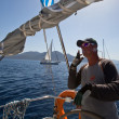 "Stock Photo: SARONIC GULF, GREECE - SEPTEMBER 23: Sailors participate in sailing regatt""VivGreece 2012"" on September 23, 2012 on Saronic Gulf, Greece."
