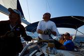 "SARONIC GULF, GREECE - SEPTEMBER 23: Sailors participate in sailing regatta ""Viva Greece 2012"" on September 23, 2012 on Saronic Gulf, Greece — Stock Photo"