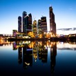 New skyscrapers Moscow business centre (Moscow City) at evening with water reflections. — Stok fotoğraf