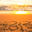 New Year 2013 is coming - inscription 2012 and 2013 on a beach sand — Stock Photo #17826167