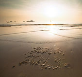 Conceptual: New Year 2013 is coming, inscription 2012 and 2013 on a beach sand — Stock Photo
