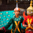 Stock Photo: SIEM REAP, CAMBODIA - DEC 13: An unidentified cambodians in national dress poses for tourists in Angkor Wat