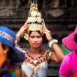 An unidentified girl in national dress poses for tourists in Angkor Wat — Photo