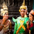 SIEM REAP, CAMBODIA - DEC 13: An unidentified cambodians in national dress poses for tourists in Angkor Wat, — Stock Photo
