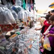 Stock Photo: BANGKOK - APR 24: Unidentified buyers shop at Chatuchak Weekend Market