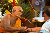 KO CHANG, THAILAND - NOV 28: Buddhist lama blesses participants Loy Krathong festival, Nov 28, 2012 on Chang, Thailand. — Stock Photo
