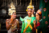 SIEM REAP, CAMBODIA - DEC 13: An unidentified cambodians in national dress poses for tourists in Angkor Wat, — 图库照片