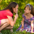 Beautiful young girl with her finger over her mouth shows for mischievous child - Shh. secret. — Stockfoto
