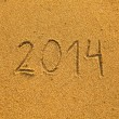 2014 written in sand on beach texture — Stock Photo