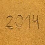 2014 written in sand on beach texture — Stock Photo