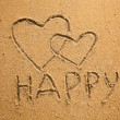 Texture of sand: the inscription happy and two hearts (concept Valentine Day) — Stock Photo