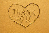 Texture of sand: the inscription inside the heart of Thank You. — Stockfoto